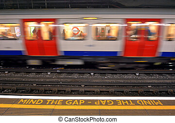 London Underground - LONDON, UK - MAY 12 2015:Passengers on...
