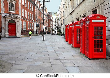 London, United Kingdom - red telephone boxes of Broad Court,...
