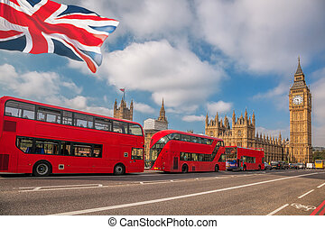 London with red buses against Big Ben in England, UK