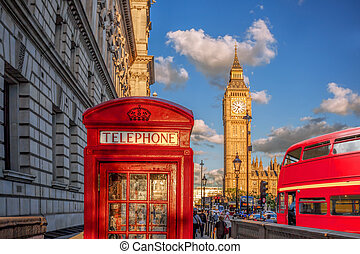 London with red phone booth against Big Ben in England, UK