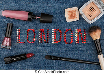 London. World capitals of fashion. Word inlaid rhinestones and cosmetics.
