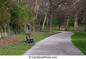 Lone bench in cemetery - Lone wooden bench in peaceful ...