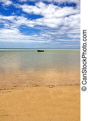 Lone boat on horizon