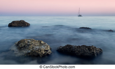 Lone boat on the horizon