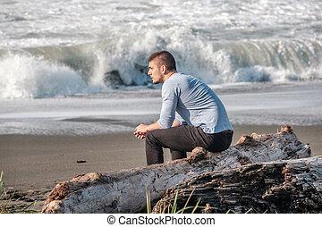 Lone man at USA Pacific coast beach - Lone man at beach,...