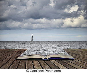 Lone sailing boat at sea with threatening storm clouds overhead concept coming out of pages in book