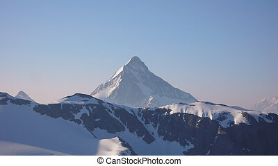 lone sharp jagged mountain peak in the Alps