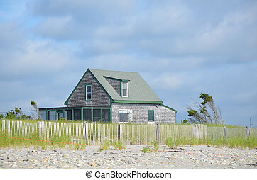 Solitary summer cottage on Duxbury beach in Massachusetts.