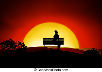Loneliness - A person sitting alone on a bench in the sunset