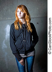 loneliness - moody portrait of a beautiful young redhead...