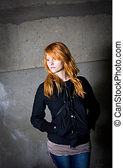 loneliness - moody portrait of a beautiful young redhead girl.