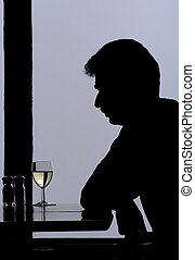 Loneliness - Middle-aged man drinking wine at the restaurant