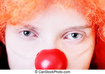 Loneliness - Close-up portrait of redhead clown with sad...