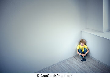 Loneliness - Little boy in corner of the room