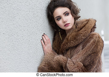 Loneliness. Winter. Beautiful Refined Female in Wool Fur...