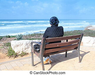 Loneliness. Woman sitting alone on