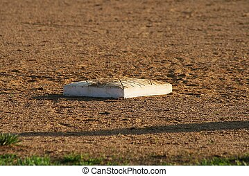 Lonely 3rd base plate on BB field - The game went onandon...