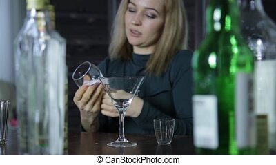 lonely barmaid clean the wineglass at bar waiting for...