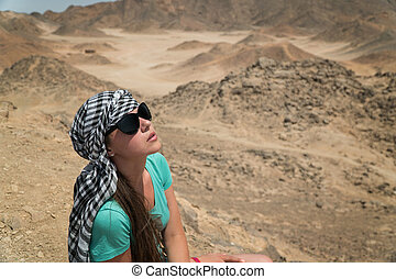 Lonely beautiful girl in the desert.