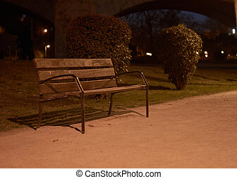 Lonely bench in the dark