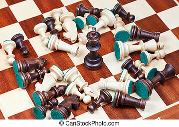 black king and scattered chess pieces