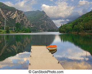Lonely boat in lake - Beautiful and peaceful lake in Vall...