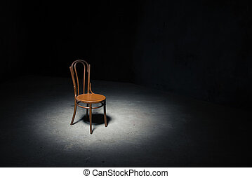 Lonely chair at the empty room