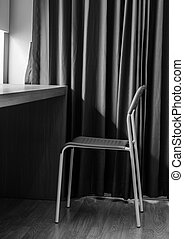 lonely chair in the hotel room: black and white tone