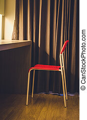 lonely chair in the hotel room: vintage tone