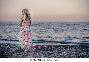 lonely child in the beach
