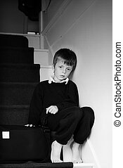 Lonely child. - Lonely child sitting on the stairs.
