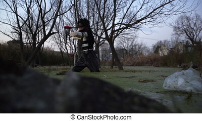 Lonely chinese girl fishing in dirty swamp. Polution, social...