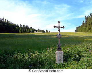 Lonely cross in the country