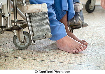 Lonely Disability Old Man on an Electric Wheelchair in the Hospital.