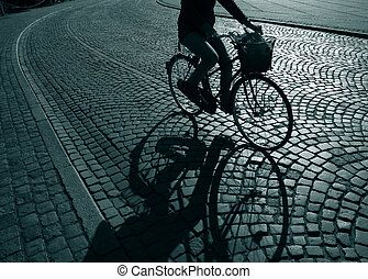 Lonely feamale cyclist on her way home from work - Denmark.