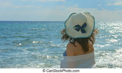 """Lonely female looking at stormy waves, summer sun sparkling in sea water surface"""