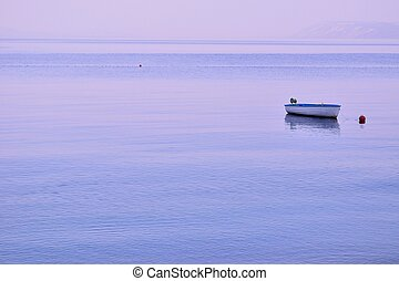 Lonely fishing boat floating on sea
