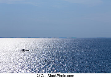 Lonely fishing boat in the ocean
