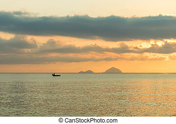 Lonely fishing boat of in sea at dawn with colorful sky