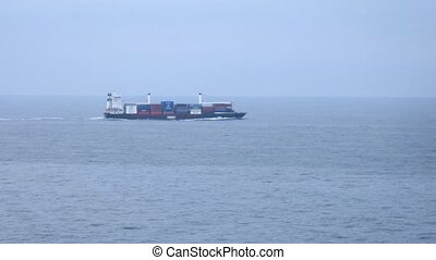 Lonely freight ship in open sea, time lapse