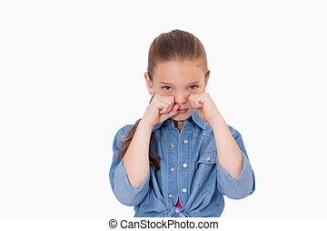 Lonely girl crying against a white background
