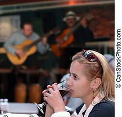 Lonely girl - Girl drinking beer alone in a restaurant with...