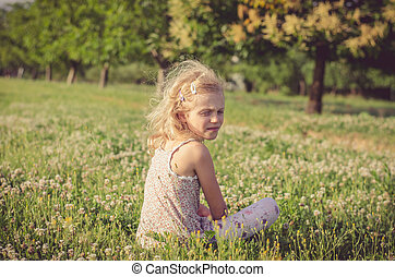 lonely girl in green spring meadow