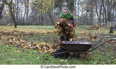 lonely girl load barrow cart in backyard.