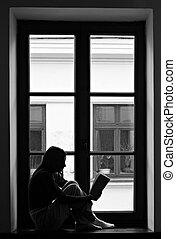 Lonely girl - Sad young girl sitting lonely on windowsill...