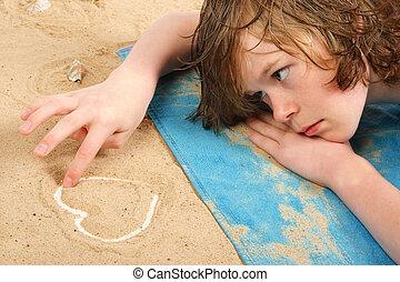 Lonely Heart - Lovelorn teenage boy lays on the beach...