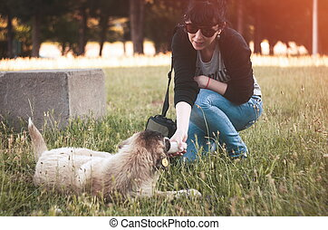 Lonely homeless dog outdoors with girl