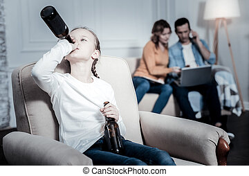 Lonely kid drinking beer