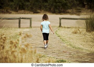 Lonely kid walking away