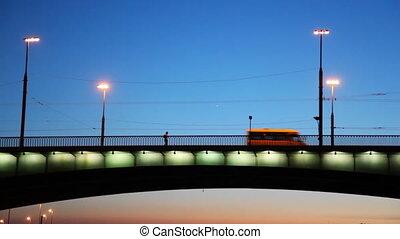 Lonely man goes by Liteyniy Bridge in night